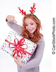 Beautiful blonde woman with reindeer antlers