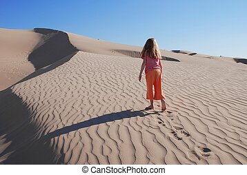 Little Girl Wandering Alone in Sand Dunes