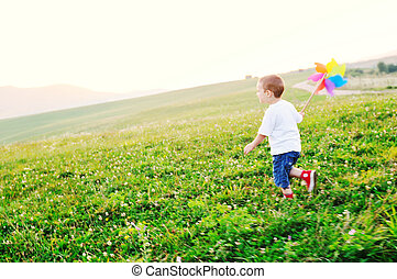 happy child have fun outdoor - little happy child play with...