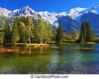 The park in the Alpine resort - Lake with cold water...