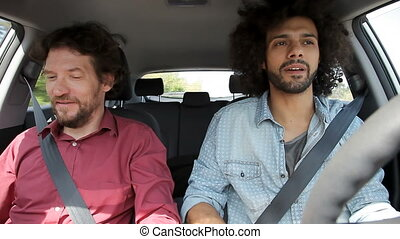Men talking about business in car