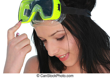 Young beautiful girl in diving mask