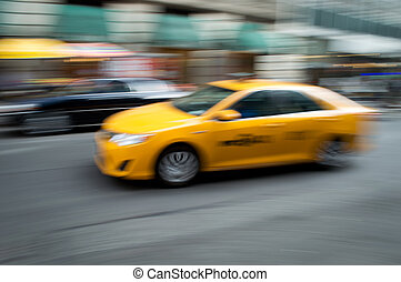 NYC Taxi Blur - A panned motion blur of a New York City taxi...