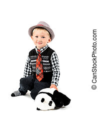 Smiling happy boy with toy shot in the studio on a white backgro