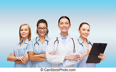 team or group of female doctors and nurses - medicine and...