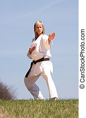 Karate girl - Karate blond girl training outdoor
