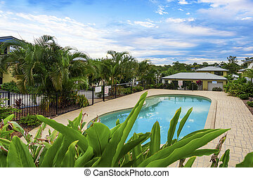 Tropical swimming pool in gated community