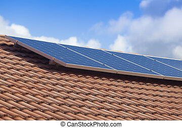 Solar panels in the sun on house roof
