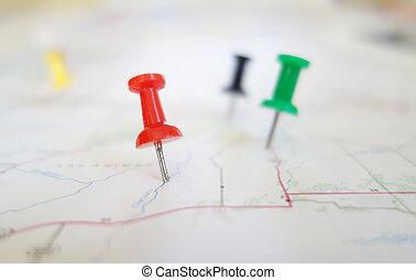 Map tacks - Closeup of push pin tacks in a map...