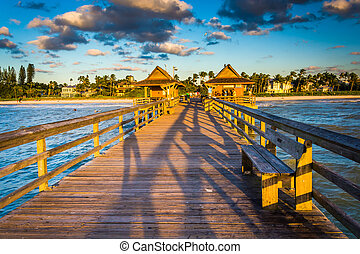 Evening light on the fishing pier in Naples, Florida. -...