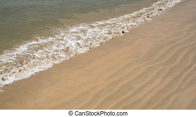 Sea Waves over Sand Beach