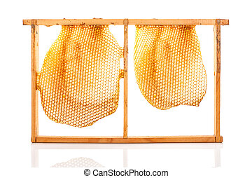 Beekeeping - Organic honey in honeycomb over white...