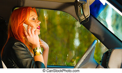 girl talking on mobile phone while driving the car - Concept...