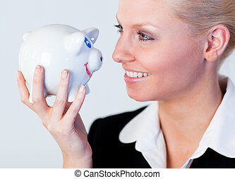 Business woman holding a piggy Bank