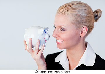 Business woman holding a piggy Bank - Young Business woman...