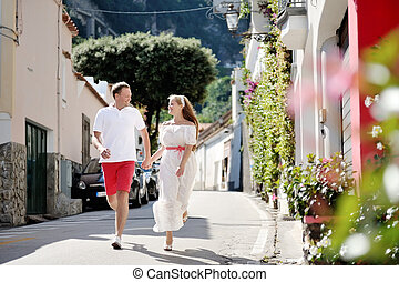 young couple running and looking each other, Positano, Italy...