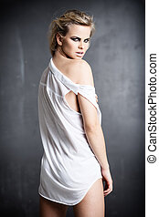 White shirt - Young angry woman in white shirt looking over...