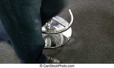 Man sits down on a bar stool - Lower part of the body; man...