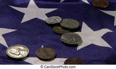 US currency and American flag