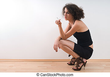 Lonely woman - Lonely young girl to kneel absorbed in...