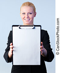 Woman holding a clipboard with the camera focus on the...