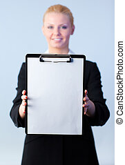 businesswoman holding a clipboard - Young attractive...
