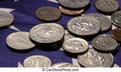 US currency and American flag - American money coins laying...