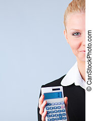 Woman calculating tax returns - Businesswoman calculating...