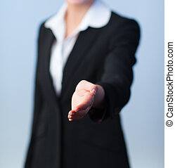 Woman offering a handshake - Busineswwoman offering a...