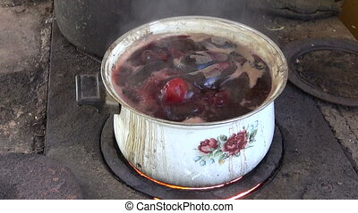 boiling pot with beet vegetable on old furnace stove