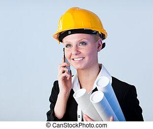 Female engineer on the phone - Female engineer talking on...
