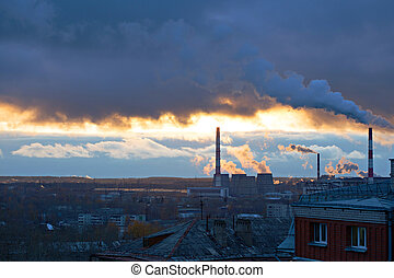 Power plant seen above residential blocks of city