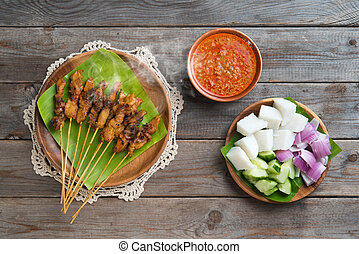 Satay - Hot and spicy Asian dish. Chicken sate or satay,...