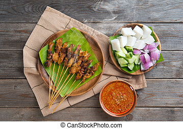 Sate - Hot and spicy Asian dish. Delicious chicken sate or...