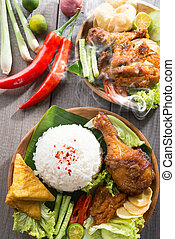 Southeast Asian food nasi ayam penyet - Popular delicious...