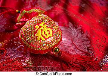 Chinese new year decorations, lucky bag on red background...