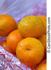 orange fruits on a basket  at the market