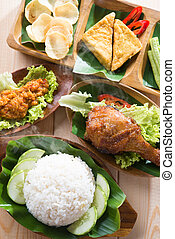 Asian food nasi ayam penyet - Famous traditional Indonesian...