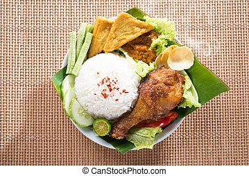 Tasty Asian food nasi ayam penyet - Popular delicious...