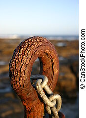 Rusty eyelet and chain located at Newcastle Baths Australia....
