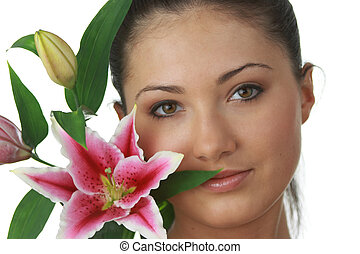 Portrait of young attractive woman with beautiful lilly...
