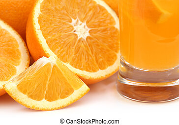 Oranges with glass of juice