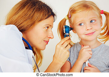 Pediatrician doctor examining little girl ears -...