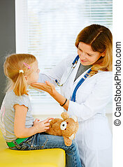 Pediatrician taking temperature with thermometer -...