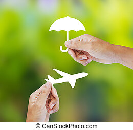 Travel Insurance - Hand holding paper on green background,...