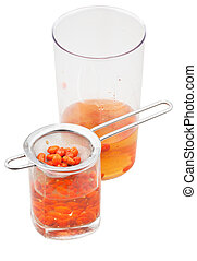 pot and glass with goji berries infusion isolated -...