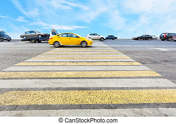 cab at yellow and white crossing zebra of pedestrian...
