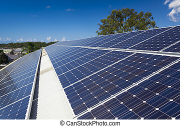 Solar panels in the sun on large roof
