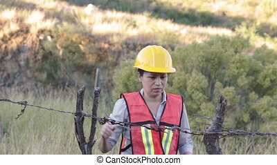 Woman Worker Barbed Wire Fence - Stressed and lost...