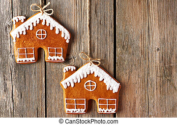 Christmas homemade gingerbread house cookies over wooden...